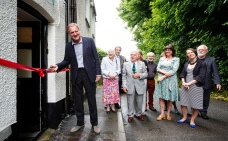 Pic: Steve Tanner. Sir Andrew Motion Patron of the Charles Causley Trust cutting the ribbon to officially open Charles Causley's house, Cyprus Well (plus from left to right: Kate Neall; Cllr Dave Gordon, Mayor of Launceston; Kent Stanton, Chair Charles Causley Trust; Alyson Hallett, Charles Causley Trust Poet in Residence, Malcolm Wright, Chair Charles Causley Society; hidden in back row- Prof. Joan Chandler, Chair Literature Works; Tracey Guiry; CEO Literature Works, Vicky Reece-Romain, Economic Policy Officer (Culture) Cornwall Council, Cllr Bert Biscoe, Cornwall Council)